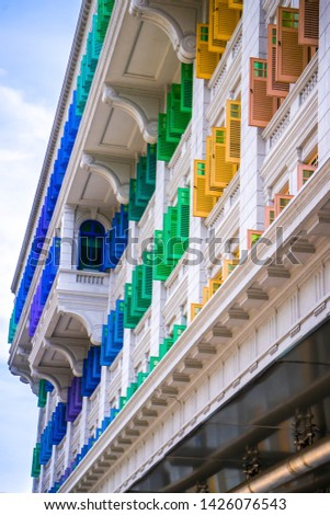 A building with vibrant windows #1426076543