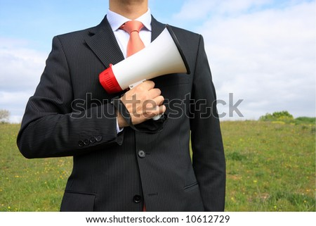 A buiness man holding a megaphone