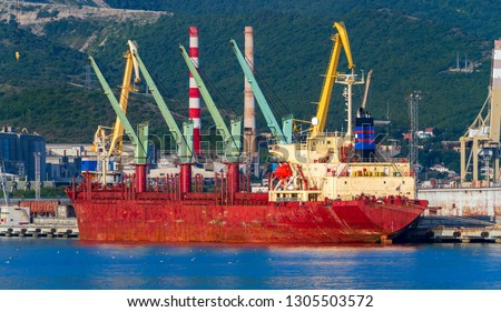 A bulk carrier in a port. Bulk freighter, or colloquially, bulker is a merchant ship specially designed to transport unpackaged bulk cargo, such as grains, coal, ore, etc in its cargo holds