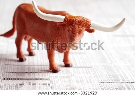 A bull on a financial newspaper