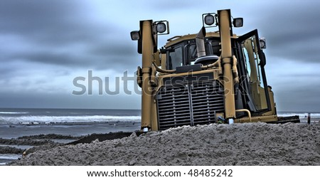 a Bulldozer the beach on a dredging project in holland HDR - stock photo