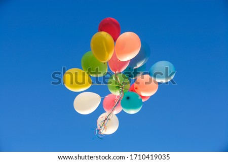 A bunch of balloons floating away