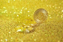 A bunch of bitcoin coins. Cryptocurrency bitcoin is the coin of the future. Golden Bitcoin. Golden shiny background. High quality photo