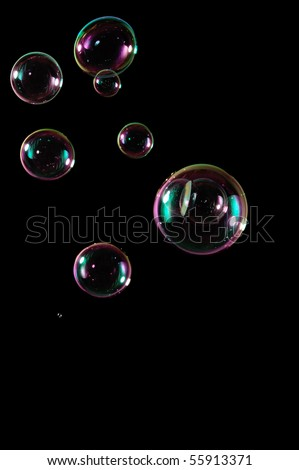 A bunch of bubbles isolated perfectly on a pitch black background.