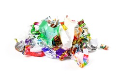 A bunch of candy wrappers on a white background. Closeup.