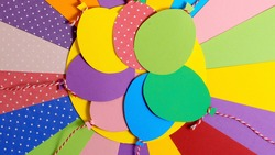 A bunch of colorful paper balloons. Balloons party invitation card. Color papers geometry flat composition background. geometric background from paper sheets. Paper art, Paper cut. Top view, Flat Lay