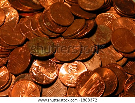 A bunch of copper pennies some shiny, some not so shiny in a pile.
