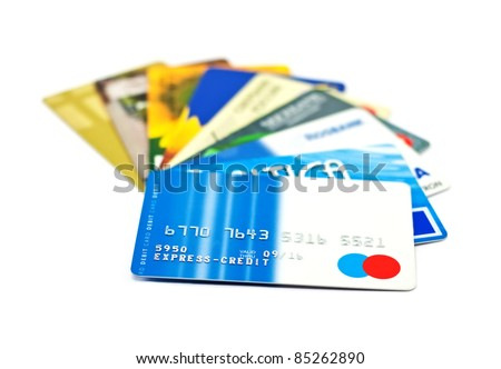 A bunch of credit cards over white