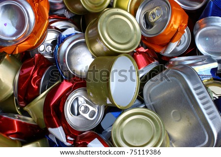 A bunch of crushed aluminum cans all together for recycling to help be green for the Earth and to be environmentally friendly