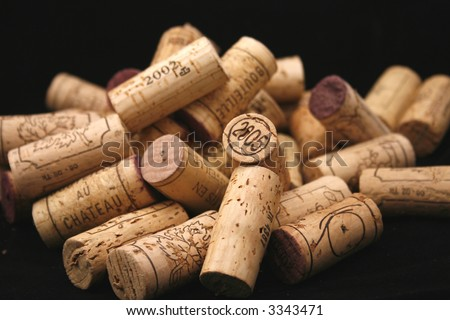 a bunch of different wine bottle corks on a black background - stock photo