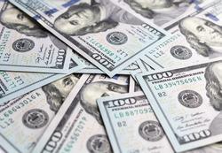 a bunch of dollar bills close up