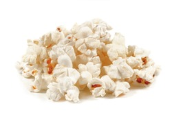 A bunch of fresh popcorn closeup on white. Salty popcorn. Top view.