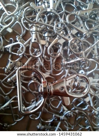 a bunch of hooked iron hangers from identification card #1459431062