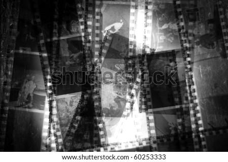 A bunch of 35mm negative filmstrips sitting on a  back light.