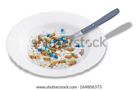 A bunch of multicolored tablets and pills in a plate on a white background