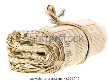 a bunch of old newspapers  isolated on white background