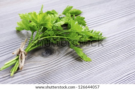 A bunch of parsley on wood background