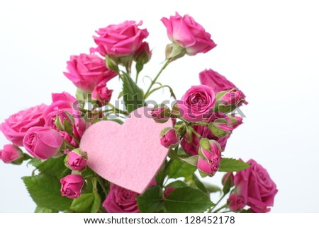 A bunch of pink roses and pink heart on Holiday