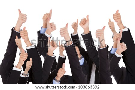 A bunch of raised hands of business people. Isolated on white