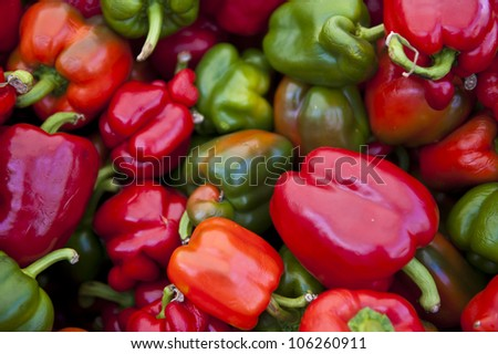A bunch of red and green peppers.