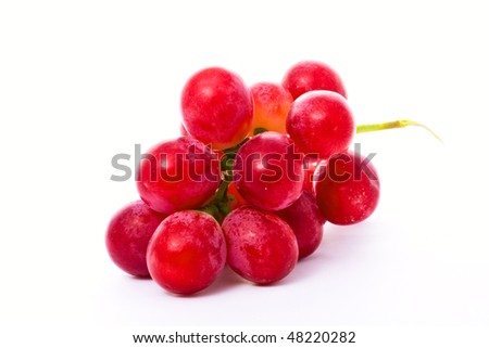 a bunch of red grape isolated on white