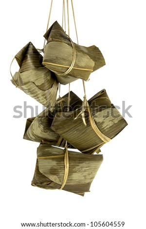 A bunch of Rice Dumplings hanging isolated on white