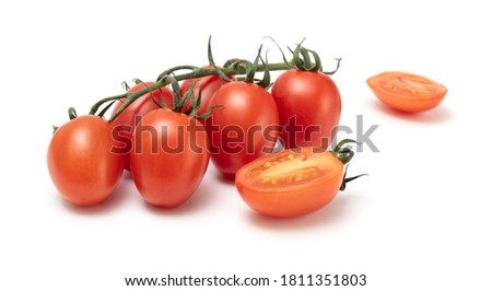 A bunch of ripe fresh Roma plum tomato isolated on white backround. Solanum lycopersicum popularly used both for canning and producing tomato paste because of its slender and firm nature. Photo stock ©
