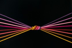 a bunch of string knotted on a black background. 8 eight color Thread String in a radial forms. Choose the color you like the best.