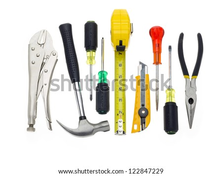 A bunch of tools hanging out on a white background