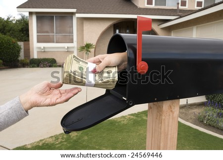 A bundle of cash is being delivered to a homeowner waiting for an economic stimulus payment or property bailout money. - stock photo
