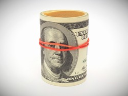 A bundle of old-style 100 dollar bills is rolled up, tied with an elastic band and placed on a white surface. Not isolated. An illustration about American money with vignetting. Close-up
