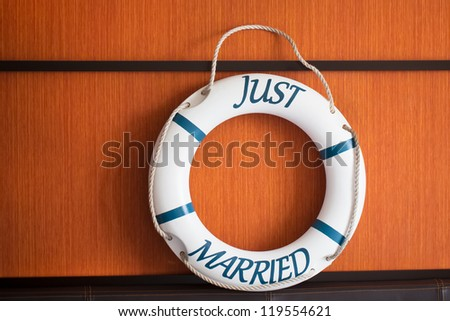A buoy on a boat with the words Just Married written on it.