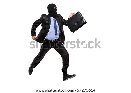 A burglar with robbery mask running away isolated on white background - stock photo