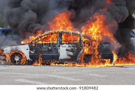 a burning car after a serious accident