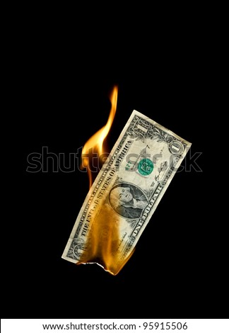 A burning dollar bill symbolizing careless money management and the phrase money to burn