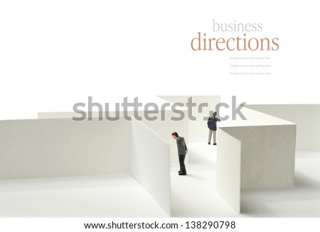 A business concept image of a maze and selective focus against a white background. Copy space. - stock photo