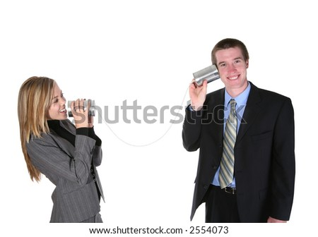 A business couple communicating on an old tin can phone