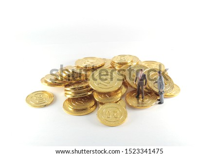A business figure stand on the gold coins. The business figure stand on the gold bitcoins #1523341475