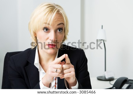 A business girl talking aggressively