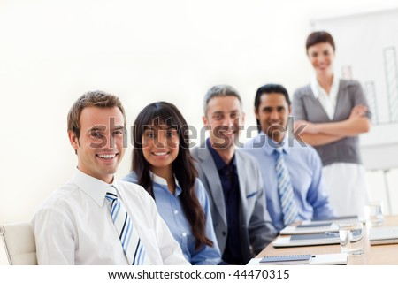 A business group showing ethnic diversity at a presentation in the office