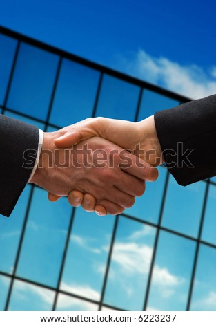 a business hand shake outside the office building