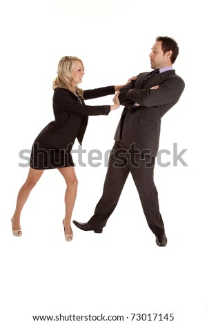 A business man and woman fighting and pushing the business man out of her way.