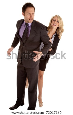A business man and woman fighting and trying to get around the man.