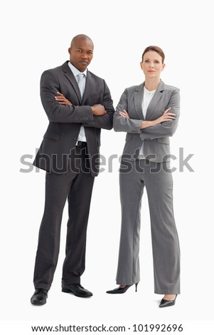 A business man and woman with their hands crossed