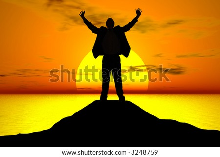 A business man celebrating his success atop a mountain at sunset