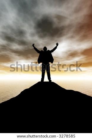 A business man celebrating his success atop a mountain at sunset