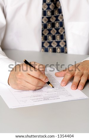 A business man filling out a form