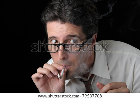 A business man furtively sneaks a hit of marijuana before heading back into the office.