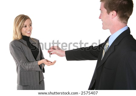 A business man handing his partner the keys to success