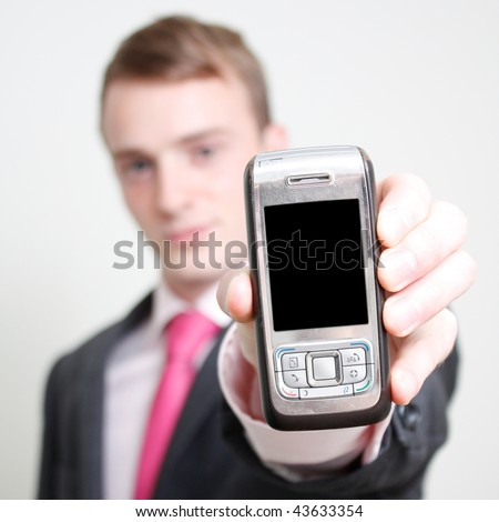 A business man holding a phone
